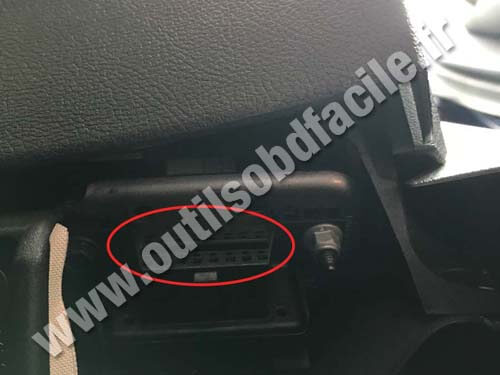 The OBD port is visible above the gas pedal