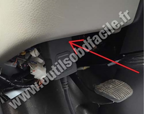 Nissan Cabstar OBD plug under steering wheel