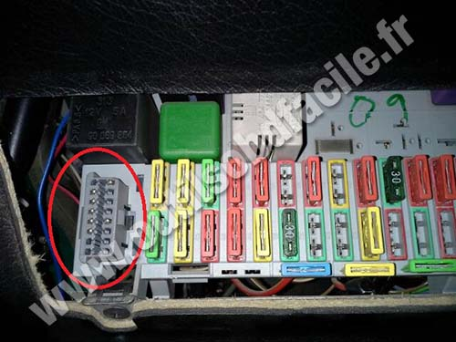 remove the fuses box cover  opel astra obd2 socket