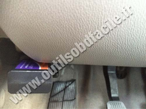 OBD Connector is located above the footrest